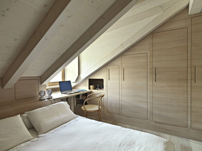 interior-view-of-a-rustic-bedroom-in-the-attic-room-with-wooden-paneling-min-e1434018333899